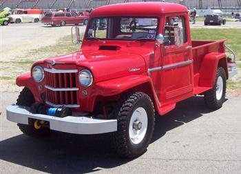 Above and Below) A beautifully restored 1962 Willys Pickup as seen at