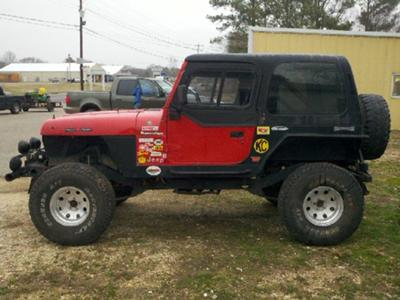 Update picture with new 15x10 rims and 35/12.50/15 tires with the hard top on.