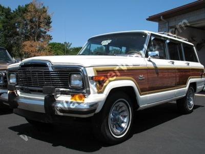 This is not mine, though it looks just like my old white 1984 Grand Wagoneer... except this restored model is worth $24,000 and mine, after being wrecked and sitting for 10 years, was sold for $1.