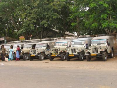 A taxi stand in south India with jeeps as taxis