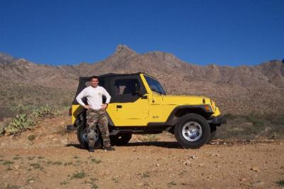 Here's a picture of my boyfriend next to the Jeep.